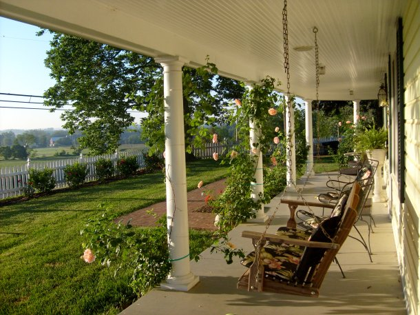 Sunrise on the front porch of farm house